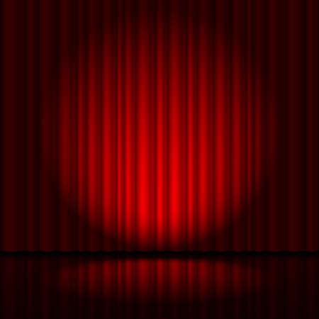 スポット ライトで劇場から赤いカーテン