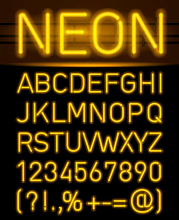 Orange set neon font and symbols isolated on black