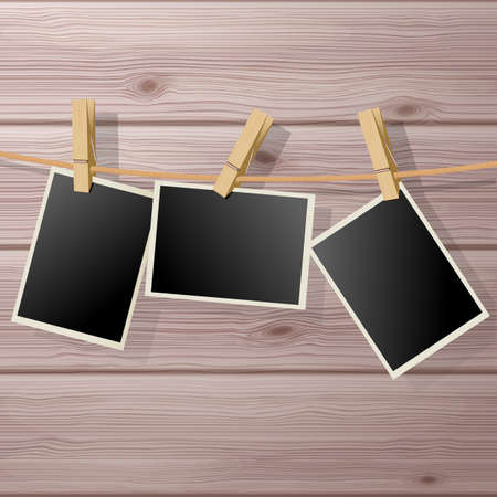 fixed: Photo Frame Fixed Hanging with Clothespins on Wooden Background