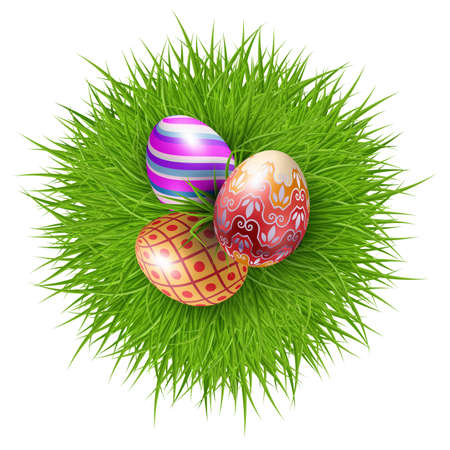 Three Brightly Colored Easter Eggs on a Round Patch of Green Grass Over white to Celebrate the Festive Season