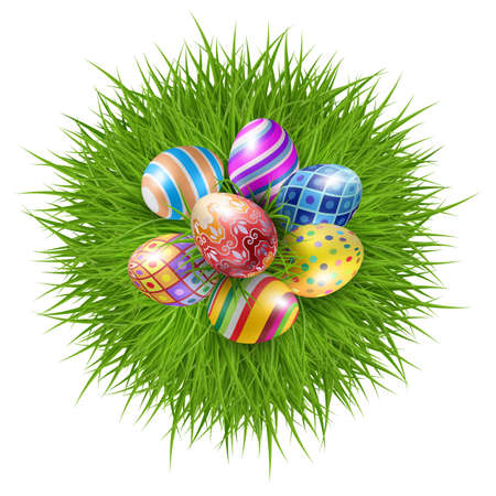 Seven Brightly Colored Easter Eggs on a Round Patch of Green Grass Over White Background to Celebrate the Festive Season