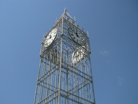 chiming: Hours with the dials focused in parts light on an iron tower