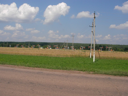 stood: Oil pumping units stood in the row on a rich field of hydrocarbons in Russia.