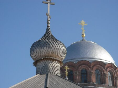 fetishism: The stone temple and church with a wooden dome topped with crosses in Sviyazhsk Stock Photo