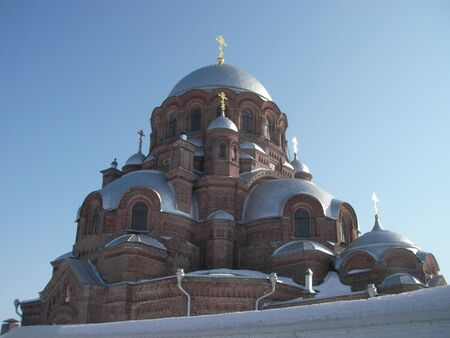 dogma: The stone temple and church with a wooden dome topped with crosses in Sviyazhsk Stock Photo