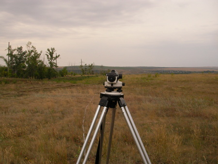 land surveyor: Making of the route for a power line in the steppe