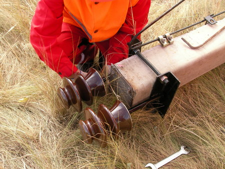 grounding: Installation of a high-voltage power line in the steppe Stock Photo