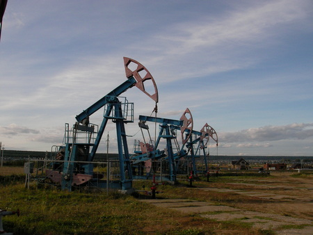 Long line of oil pumping units on a large-scale deposit of hydrocarbonic raw materials
