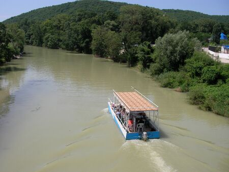 vacationers: The walking boat rolls down the river tourists and vacationers