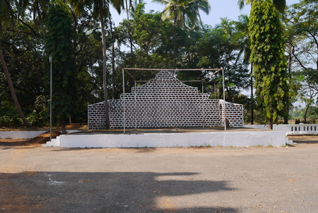 arbor: The arbor in the form of a brick wall is constructed under trees on the monastic yard