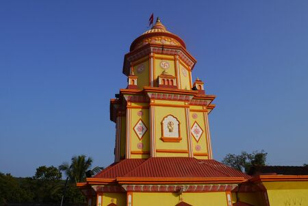 dome of hindu temple: Brightly painted Hindu temple with a swastika in India Stock Photo