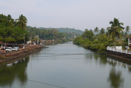confluence: The river of the Bug in the State of Goa at a confluence with the Arabian Sea