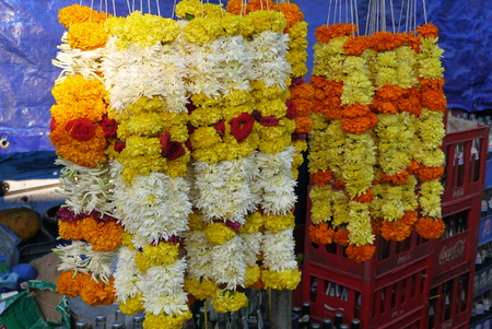 house of god: ritual wreaths from different flowers for decoration of houses and a gift to gods