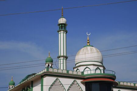 Mosque with a minaret of modern architecture for a fulfillment of Muslim sermons and Mohammedan prayers Stock Photo