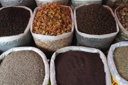 seasonings: spices and seasonings in bags in the market Stock Photo