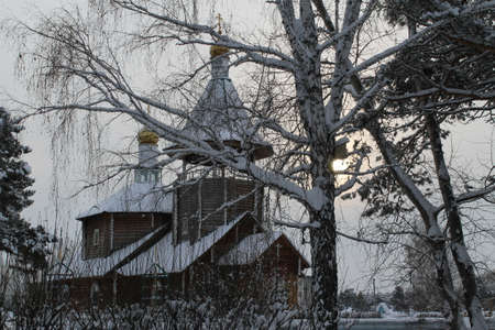 gold road: small rural church in a midland of Russia