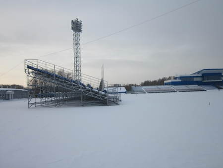 juridical: The football field and tribunes are powdered with snow in the open air in the winter