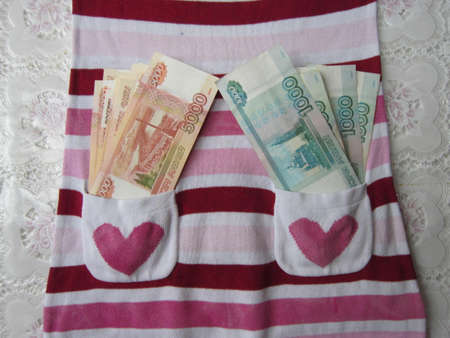 full filled: Full of money of a striped sundress are filled the pockets with large notes