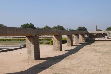 merged: Ancient viaduct in the royal center in Hampi water with which merged in a big ritual bath