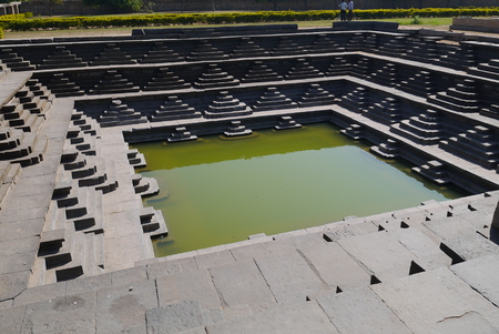 ritual: Big ritual bath at royal center of Hampi water in which arrived on an ancient viaduct Stock Photo