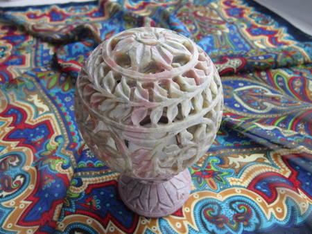 carved stone: carved stone candlestick on a multi-colored background