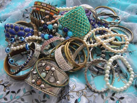 costume jewelry: Various jewelry from a tree, pearls, gold, plastic and stones is collected in one heap