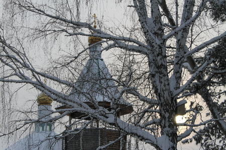 snowcovered: the small church on the suburb has sat down among snow-covered trees