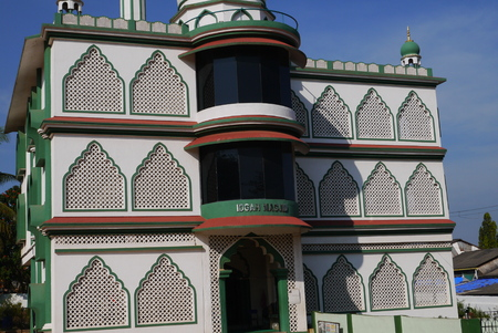 dogma: Mosque with a minaret of modern architecture for a fulfillment of Muslim sermons and Mohammedan prayers Stock Photo