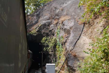 cut through: the tunnel is cut through in mountains for railway tracks