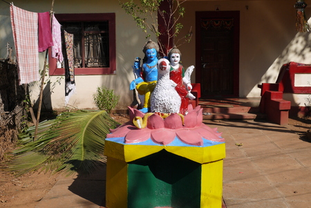parvati: Sculpture of god Shiva and his spouse Parvati in the yard of the Indian hut Stock Photo