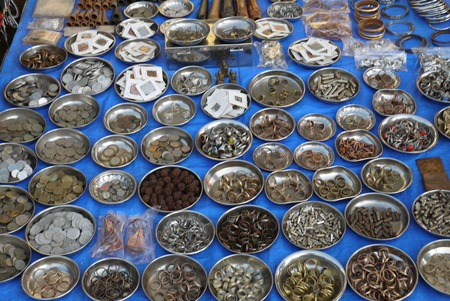 trifle: Sale in a hardware bench in the market of various metal trifle and a hardware