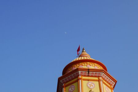 swastika: Brightly painted Hindu temple with a swastika in India Stock Photo