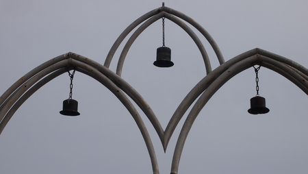 pedestrian bridges: Arch entrance on the pedestrian bridge with the bells suspended on a chain