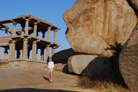 an era: the woman examines ancient temples of the Vidzhayanagarsky era in the village of Hampi in India