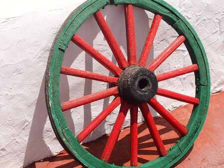 iron hoops: The wooden wheel fitted by an iron rim for the animal-drawn vehicle Stock Photo