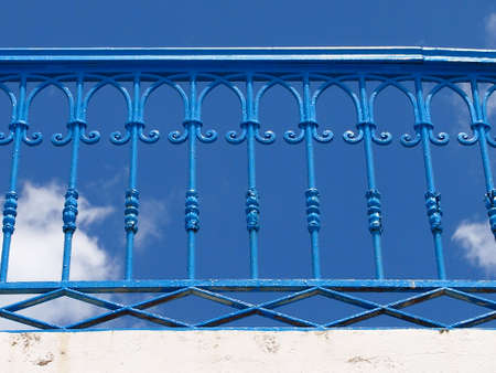 place of interest: blue lattice of the bridge against the blue sky with clouds Stock Photo