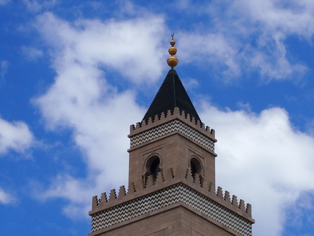 devout: The minaret of the Muslim mosque towering highly in the sky Stock Photo