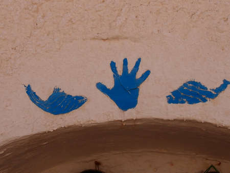 dwelling: The image of fishes and Fatimas hand in case of an entrance to the dwelling of berbers