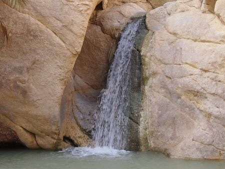 mountain oasis: Falls in a mountain oasis in Atlasky mountains in North Africa Stock Photo