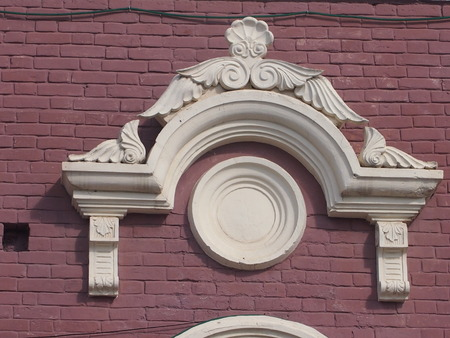 town planning: The stucco molding on a house wall made of plaster, decorates a building facade