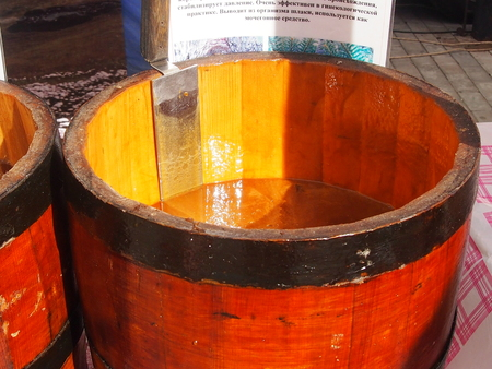 odorous: Fresh, odorous honey in lime kegs is on sale at a fair