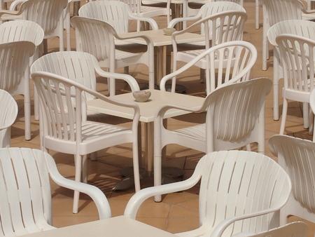 verandah: empty little tables in cafe on an open verandah