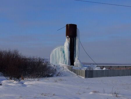 Type of a water tower in the village in the winter