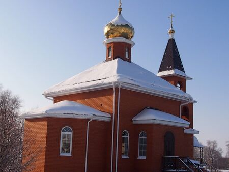 belltower: Roadside orthodox church with a belltower against the background of the winter sky