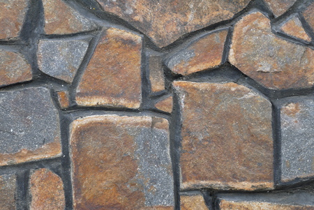 floor covering: The wall revetted with stones of various geometrical form Stock Photo