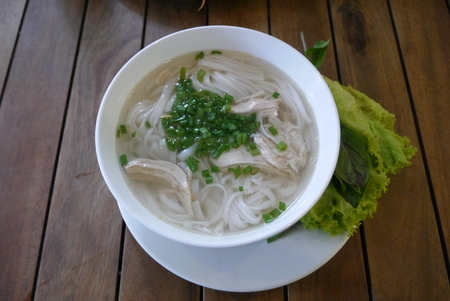 The small pan of soup pho since morning - the most that dish capable to disperse a stomach and to fill an organism with food and energy Stock Photo