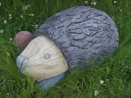 The hedgehog figure for decoration of a garden or a kitchen garden
