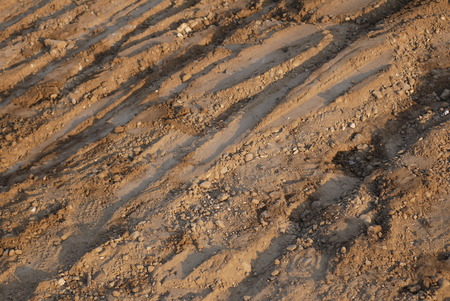 Lifeless marsiasky landscape with stones and furrows on the surface of the soil