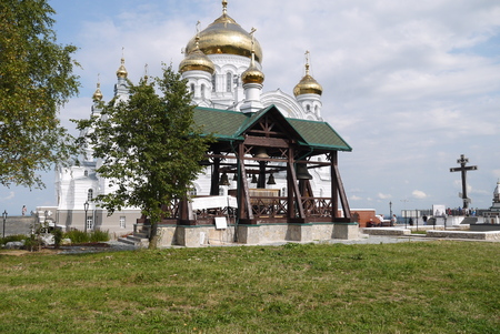 The covered belfry with bells in the case of the mens orthodox monastery