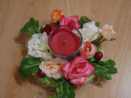 Production of the decorative candlesticks decorated artificial with flowers Stock Photo